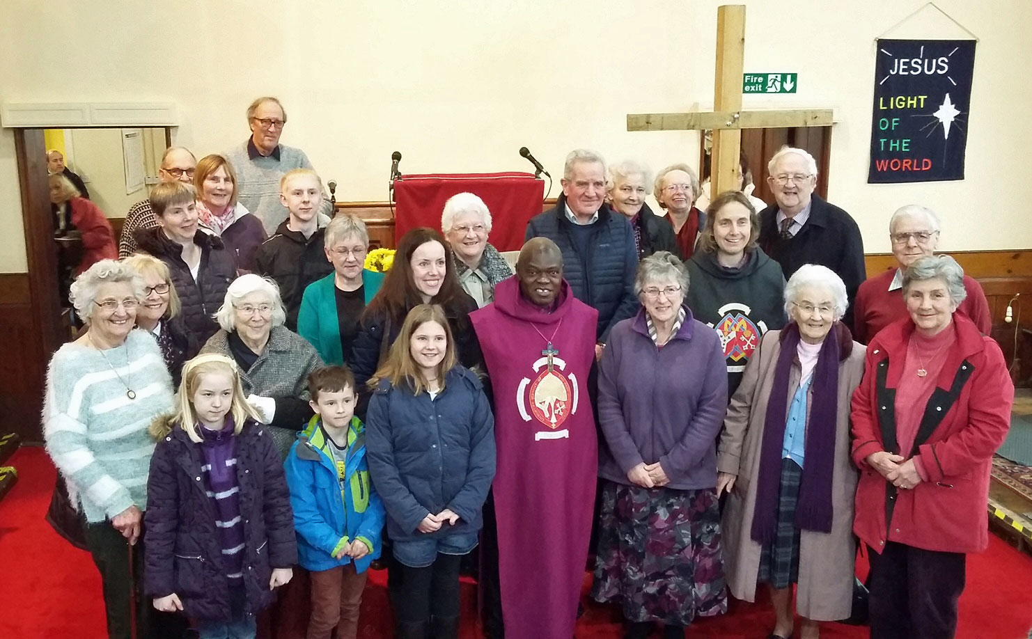 Group of people in church with Archbishop when on Pilgrimage in Howden