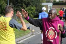 Archbishop high fives runners in the Yorkshire Marathon