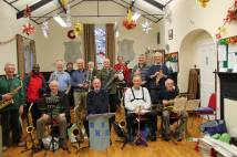 Archbishop with brass band on pilgrimage at Christmas