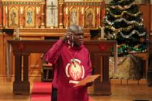 Archbishop leading prayers at Christmas