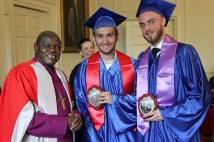 Archbishop of York with 2 graduands from Archbsihop Sentamu Academy