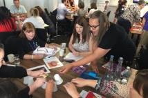 Teachers engaged in table activity at Young leaders conference