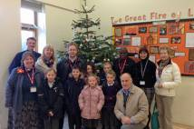 Saltburn Primary School - Archbishop standing with Christmas tree and pupils
