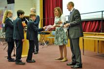 Students receive Young Leaders Awards from Headteacher and Youth Trust staff member