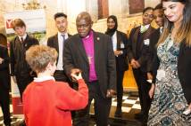Archbishop shakes hands with pupil from Heworth Primary School