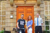 Graeme Holdsworth, Claire Readey, Martin Gibson standing outside Cranmer Hall with a bicycle
