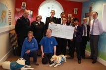 Students with giant cheque for local charities