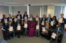 Students with Young Leaders Award certificates at Abbey Grange School