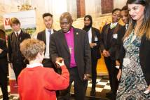 Archbishop shakes hands with a pupil at Bishopthorpe Palace