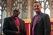Archbishop of York standing in York Minster with new Dean of York