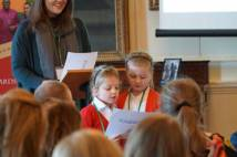 Two pupils sharing their experience of the KS1 Young Leaders Award in the Great Hall at Bishopthorpe Palace