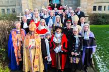 Archbishop of York, clergy, lawyers, judges and dignitaries standing outside Bradford Cathedral, robed and wigged