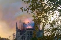 Notre-Dame Cathedral with flames rising from the roof