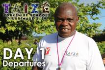Archbishop outside wearing Taize tshirt