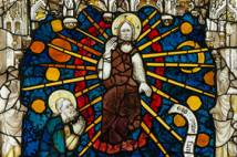 Close up of stained glass window showing God sitting in judgement