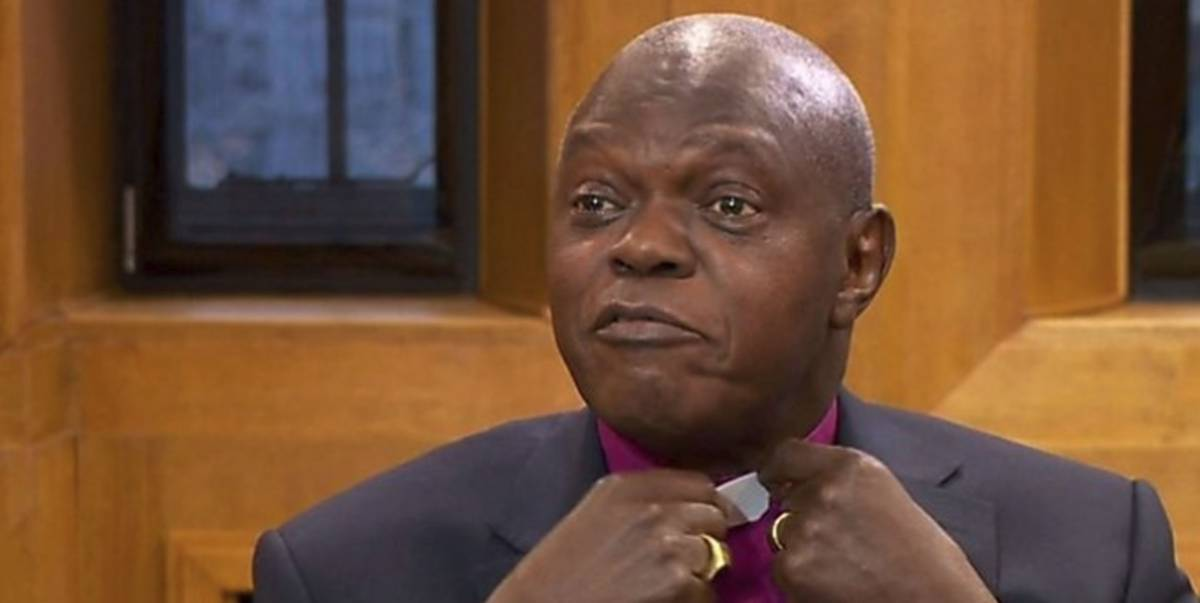 Archbishop on Andrew Marr show putting on his clergy collar