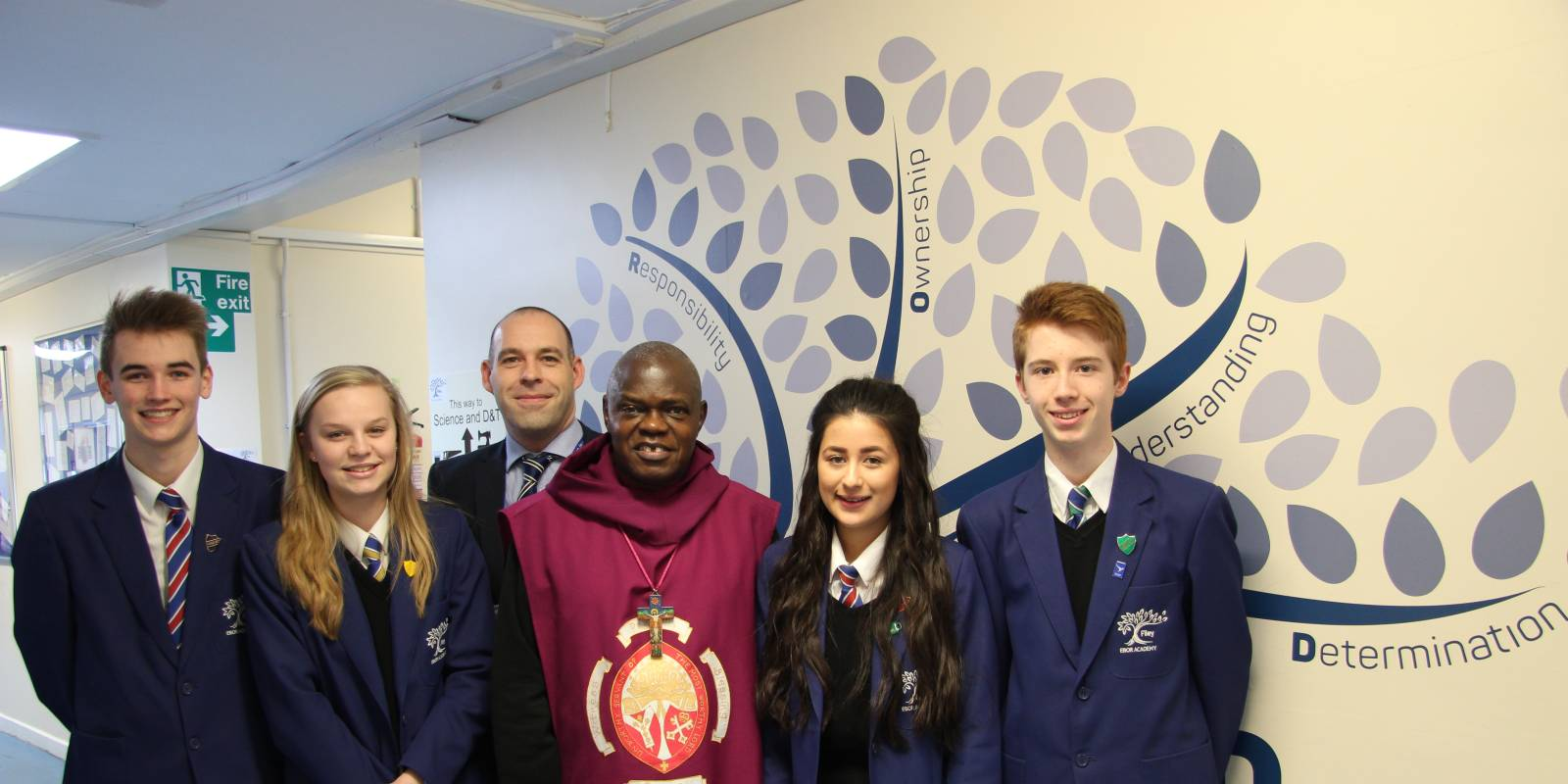 Archbishop of York standing with students in corridor