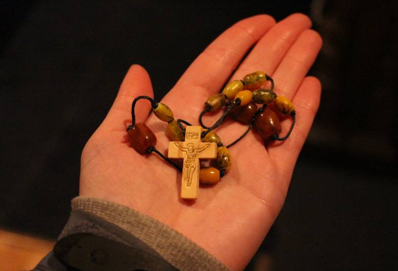 Pilgrimage Prayer Beads held in hand