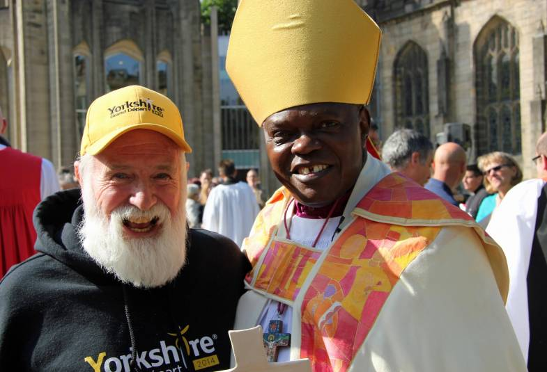 Archbishop stands with man outside Sheffield Cathedral