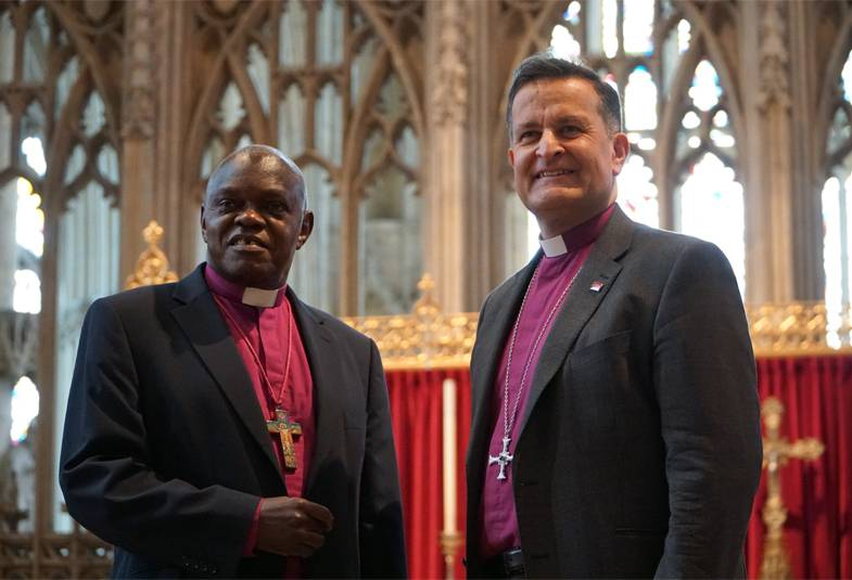 Archbishop of York standing in York Minster with the new Dean The Rt Revd Jonathan Frost