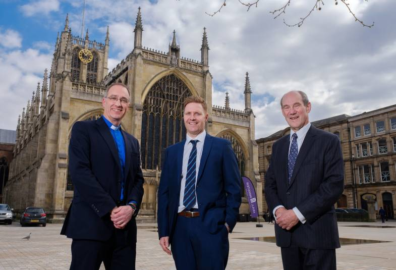 Vicar Neal Barnes, Highways England Senior Project Manager James Leeming and Hull Minster Development Trust Vice Chair Stephen Martin at the event marking their partnership.