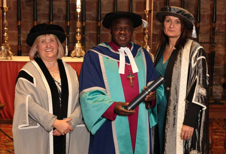 Professor Diane Cox with the Archbishop of York and Vice Chancellor Professor Julie Mennell after Dr Sentamu was presented with the university's first honorary doctorate, Carlisle Cathedral.