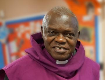 Head and shoulders of the Archbishop of York wearing a purple scapula