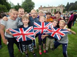 Children with Union flags at party at Bishopthorpe Palace