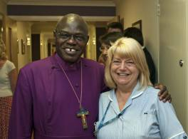 Archbishop with a nurse at Cross Lane Hospital