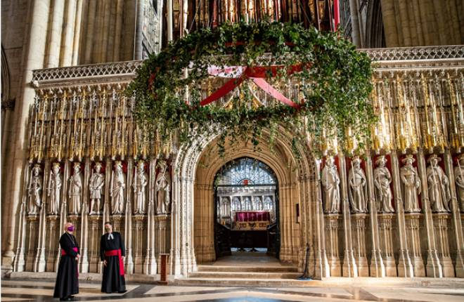 Archbishop and the Dean stood inside York Minster as the 4m wide Advent wreath is raised