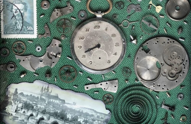 Pieces of a dismantled timepiece on a green background